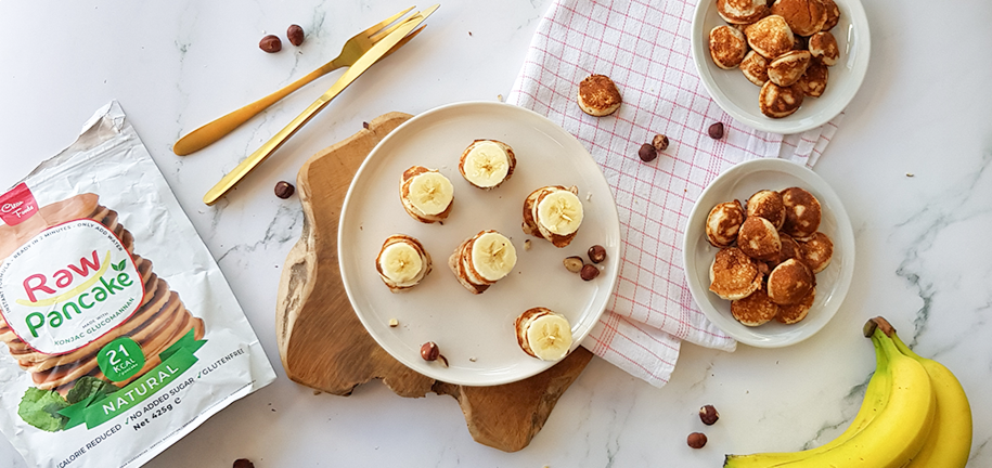 Snack con poffertjes (mini-pancake) alla banana